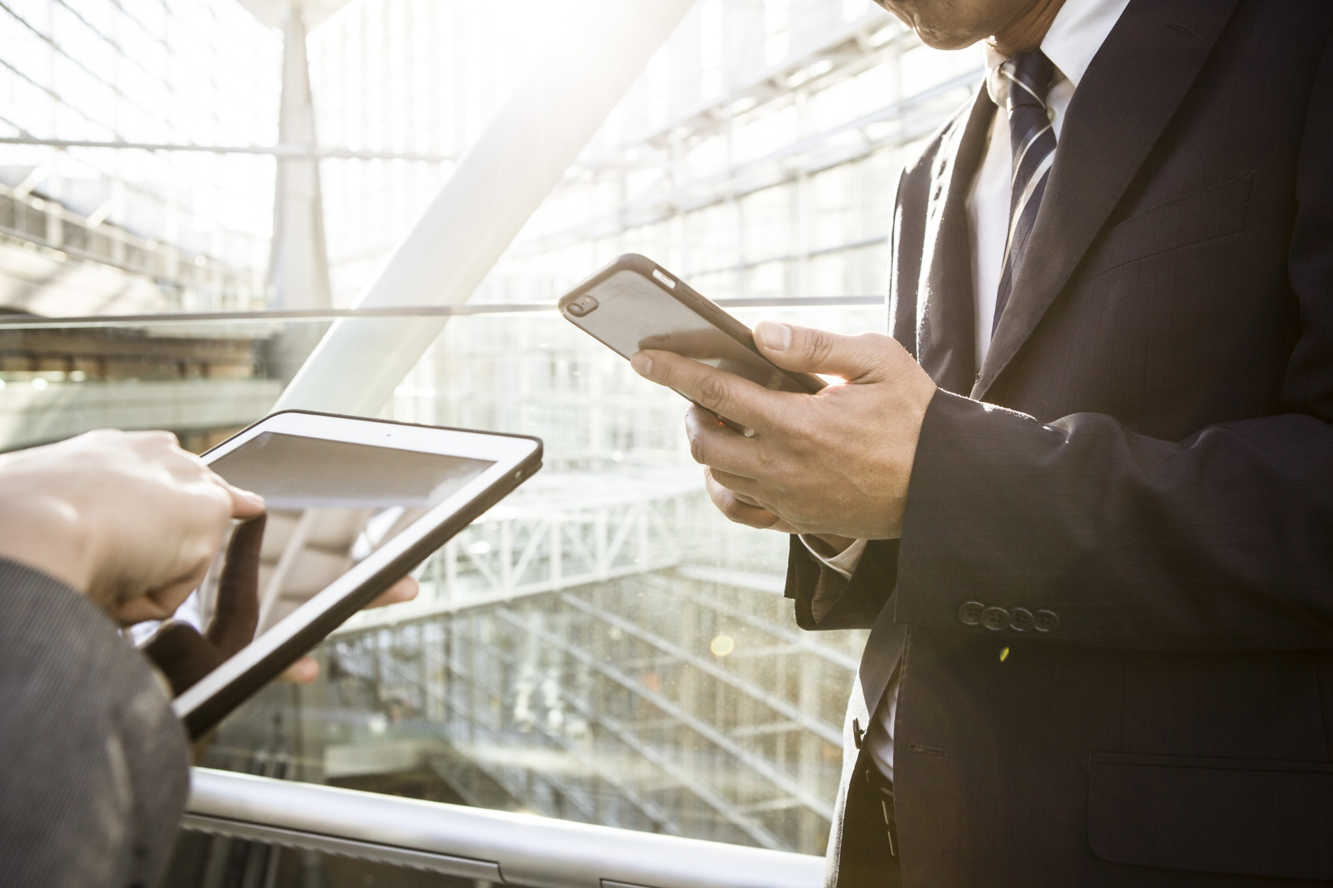 Businessmen are using the new mobile phone