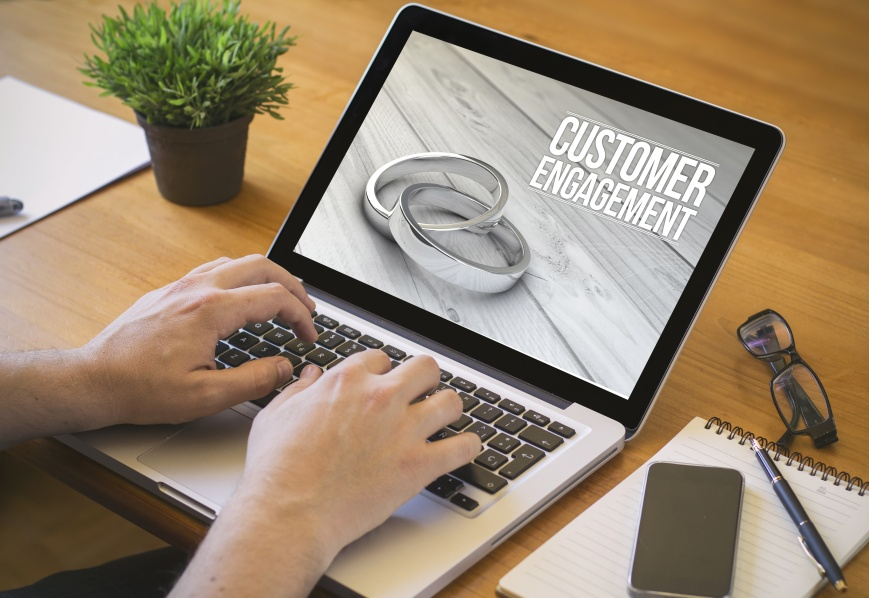 online marketing engament concept. Close-up top view of a businessman working on laptop. all screen graphics are made up.